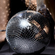 Fishnet stockings and disco ball — Stock Photo
