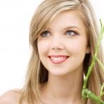 Blue-eyed blonde with bamboo — Stock Photo #11766330