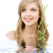 Blue-eyed blonde with bamboo in water — Stock Photo #11766654
