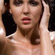 Brunette girl in water — Stockfoto
