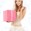 Santa helper in corset and skirt with pink gift box — Stock Photo #11766778