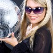Party girl with disco ball — Stok fotoğraf