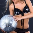 Party dancer in black lingerie with disco ball — Stock Photo #11767177
