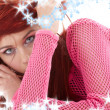 Mysterious redhead in pink fishnet — Stock Photo
