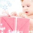Baby boy with gift box — Stock Photo #11767763