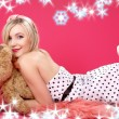 Lovely blond with teddy bear over pink — Stock Photo
