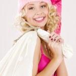 Cheerful santa helper girl with big bag — Stock Photo