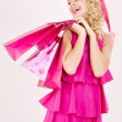 Cheerful santa helper girl with shopping bags — Stock Photo #11768009