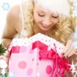 Lovely santa helper girl with christmas gifts — Stock Photo