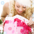Lovely santa helper girl with christmas gifts — Stock fotografie