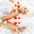 Red petals spa with water — Foto de Stock