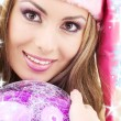 Santa helper girl with ball — Stock Photo #11768278