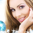 Happy woman with blue christmas ball — Stock Photo #11768284