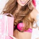 Cheerful santa helper girl with gift box — Stock Photo #11768285