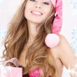 Cheerful santa helper girl with gift box — Stock Photo #11768287