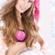 Santa helper in pink lingerie with disco ball — Stock Photo #11768288