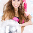 Santa helper in pink lingerie with disco ball — Stock Photo #11768290