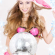Santa helper in pink lingerie with disco ball — Stock Photo #11768294