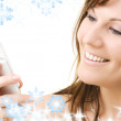 Happy woman with white phone — Stock Photo #11768419