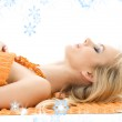 Beautiful lady with orange towels — Stock Photo #11768534