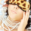 Pearls and leopard mask - Stockfoto