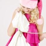 Cheerful santa helper girl with big bag — Stock Photo #11768650