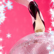 High heels and disco ball — Stock Photo