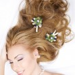Lovely woman with christmas decorations in hair — Stock Photo #11769100