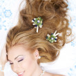 Lovely woman with christmas decorations in hair — Stock Photo #11769194