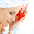 Happy woman with red flower petals — Stock Photo #11769216