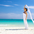 Happy woman with white sarong — Stock Photo #11769818
