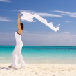 Happy woman with white sarong — Stock Photo #11769830