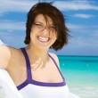 Happy woman with white sarong — Stock Photo #11769872