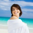Happy woman with white sarong — Stock Photo #11769875