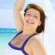Happy woman with white sarong — Stock Photo #11769897