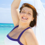 Happy woman with white sarong — Stock Photo