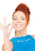 Lovely redhead showing ok sign — Stock Photo