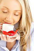 Blond with cup of coffee and chocolate — Stock Photo