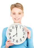 Woman holding big clock — Foto de Stock