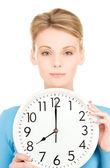Woman holding big clock — Foto Stock