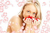 Lovely blond with red and white rose petals and rendered flowers — Stock Photo