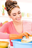 Housewife washing dish — Stock Photo