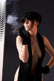 Woman in black astrakhan smoking cigar — Stock Photo