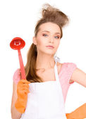 Housewife with red ladle — Stock Photo