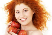 Happy redhead with red apples — Stock Photo