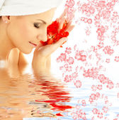 Lady with red petals and flowers in water — Foto de Stock