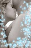 Monochrome sensuality with blue flowers — Stock Photo
