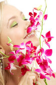 Happy blond with orchid — Stok fotoğraf
