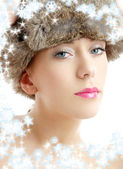 Lovely beauty in winter hat with snowflakes — Stock Photo