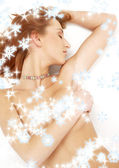 Sleeping redhead with colorful collar ans snowflakes — Stock Photo